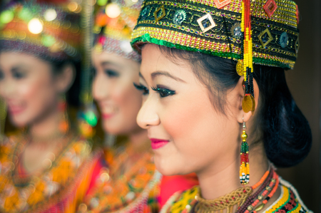 toraja: Makale, Indonesia - May 2015: Photo of beautiful girl wearing traditional costume with hat with jewellery made of beads smiling during wedding in Makale, capital city of Tana Toraja Regency, South Sulawesi, Indonesia. Documentary editorial. Editorial