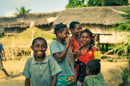 Will-will, Papua New Guinea - July 2015: Young children smile joyfully and look to photocamera in Will-will, Nuku, Papua New Guinea. Documentary editorial. Editorial