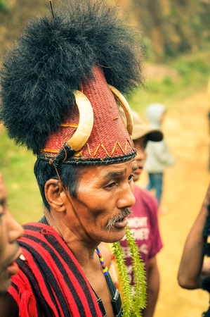 documentary: Wanching, Nagaland - April 2012: Photo of older man with traditional large hat on his head during Aoleang festival in Wanching, Nagaland. Aoleang is festival with indigenous dances, songs and games. Documentary editorial.
