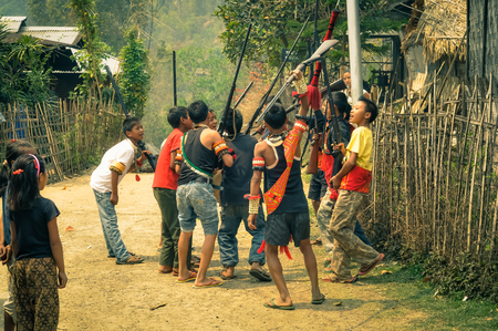 nagaland: Wanching, Nagaland - April 2012: Photo of group of native boys holding rifles during Aoleang festival in Wanching, Nagaland. Documentary editorial.