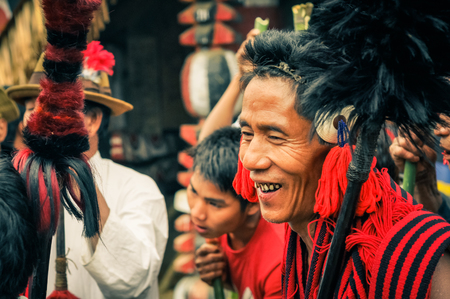 documentary: Wanching, Nagaland - April 2012: Smiling native man in black and red scarf looks to left at Aoleang festival in Wanching, Nagaland. Aoleang is main festival of Konyaks from northern Nagaland  with indigenous dances, songs and games. Documentary editorial.