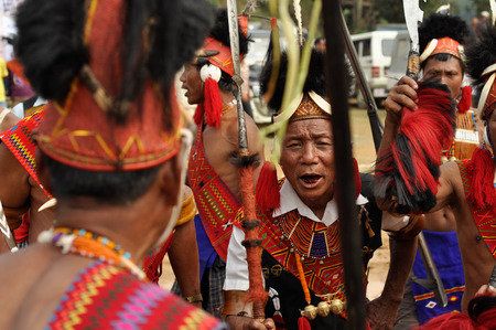 documentary: Mon, Nagaland - April 2012: Photo of native man in traditional costume singing and dancing during performance at Aoleang festival in Mon, Nagaland. This festival showcases rich cultural heritage of this country. Documentary editorial. Editorial