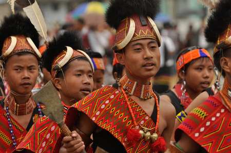 nagaland: Mon, Nagaland - April 2012: Boys in costumes and traditional hats wait for their performance at Aoleang festival in Mon, Nagaland. Aoleang is biggest and most significant festival of Konyak Nagas of Nagaland. Documentary editorial.