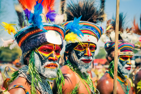 Hagen show, Papua New Guinea - circa August 2015: Two native half-naked men with colours on their faces and beards during Hagen show, Papua New Guinea. Documentary editorial. Editorial