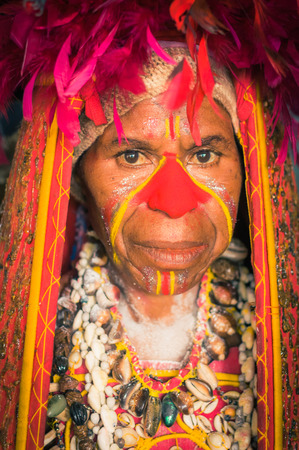 headcloth: Hagen show, Papua New Guinea - circa August 2015: Native woman dressed in traditional costume during preparation for Hagen show, Papua New Guinea. Documentary editorial.