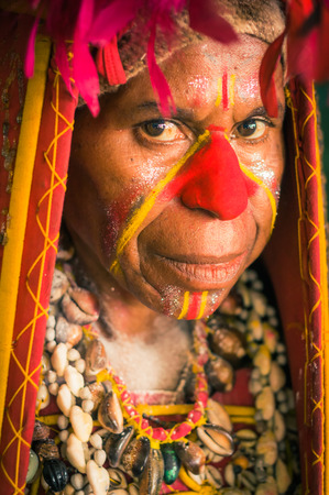 headcloth: Hagen show, Papua New Guinea - circa August 2015: Native woman during preparation for Hagen show, Papua New Guinea. Documentary editorial.