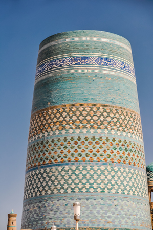 oriented: Large column with many colourful ornaments and paintings in Khiva in Uzbekistan. Editorial