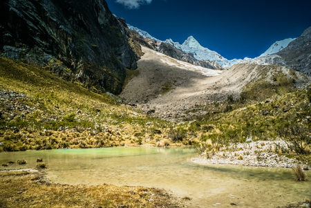 Photo of countryside and Alpamayo in Parque Nacional Huascaran in Peru, South America.