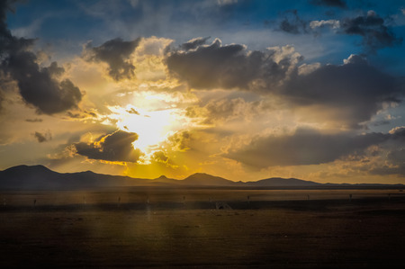 Photo of sunset on cloudy sky in Ala Archa National Park in Kyrgystan. Stock Photo