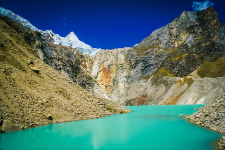 Photo of lagoon and Alpamayo, one of peaks in Peruvian Andes in Parque Nacional Huascaran in Peru, South America.