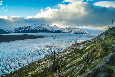 Wilderness with permanent glaciers and snow-capped mountains in distance in Parque Nacional Torres del Paine in Chile.