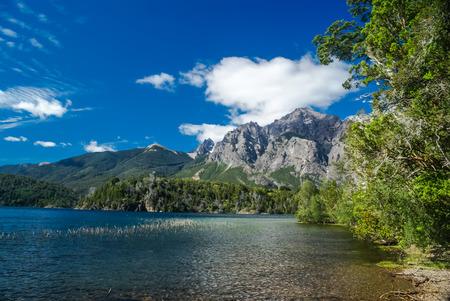 Rich greenery surrounding river in Bariloche, city in province of Rio Negro in Argentina.