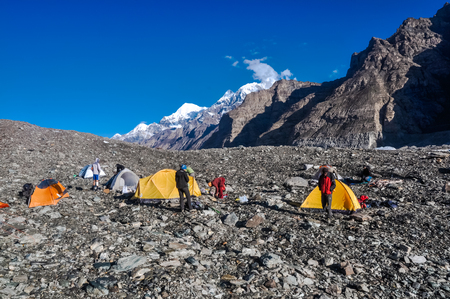 glaciar: Photo of tents of hikers on rocks near South Inylcheck Glaciar in Kyrgystan.