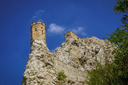Photo of old stone tower of castle built on rock in Bratislava in Slovakia.