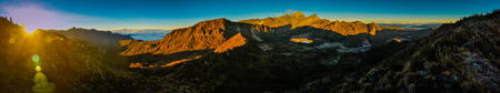 Panoramic photo of mountainous landscape in morning sunlight during sunrise in Trikora, Papua, Indonesia. This is very remote location, rarely visited by people.