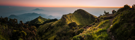 Panoramic photo of dormant stratovolcano, Mount Merbabu, and surrounding mountains near Yogya in central Java province in Indonesia. This is very remote location, rarely visited by people.