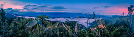 Darkness and evening fog above mountains in Digne in Kubor range, Papua New Guinea. In this region, one can only meet people from isolated local tribes. Stock Photo
