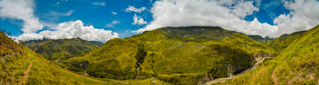 Panoramic photo of mountains of rich greenery in Dani circuit near Wamena, Papua, Indonesia. In this region, one can only meet people from isolated local tribes.