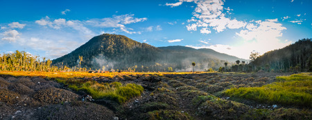 Panoramic photo of field and mountain near village in Trikora, Papua, Indonesia. In this region, one can only meet people from isolated local tribes.