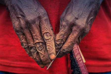 Photo of womans hands marked by time and hard work in Dani circuit near Wamena, Papua, Indonesia.  In this region, one can only meet people from isolated local tribes.