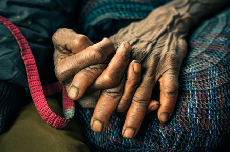 Photo of wrinkled hands of woman marked by time and hard work in Dani circuit near Wamena, Papua, Indonesia.
