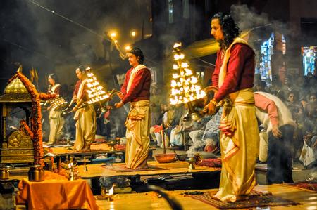 uttar pradesh: Varanasi, Uttar Pradesh - circa January 2012: Men with burning candlestands in their hands pose during ceremony in Varanasi, Uttar Pradesh. Documentary editorial.