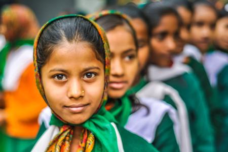 Bohdgaya, Bihar - circa January 2012: Young girls in school uniforms stand in row at school in Bohdgaya, Bihar. Documentary editorial.