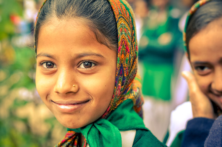 Bohdgaya, Bihar - circa January 2012: Young pretty girl with headcloth and nosering smiles and poses in Bohdgaya, Bihar. Documentary editorial.