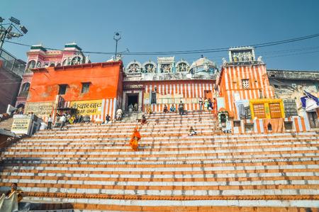 uttar pradesh: Varanasi, Uttar Pradesh - circa January 2012: Photo of people on stairs in front of building in Varanasi, Uttar Pradesh. Documentary editorial.
