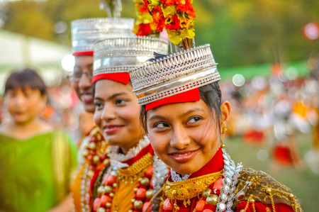 Shillong, Meghalaya - circa April 2012: Smiling girls in traditional costumes with large beads and crowns on their heads at Shad Suk Mynsiem Festival in Shillong, Meghalaya. Documentary editorial.
