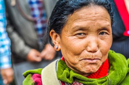 Bohdgaya, Bihar - circa January 2012: Native woman with pretty face looks timidly to photocamera in Bohdgaya, Bihar. Documentary editorial.