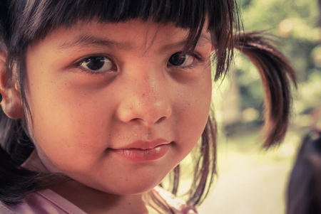 Villa Alcira, Bolivia -circa June 2009: Young girl with ponytail at Villa Alcira, Bolivia. Documentary editorial.