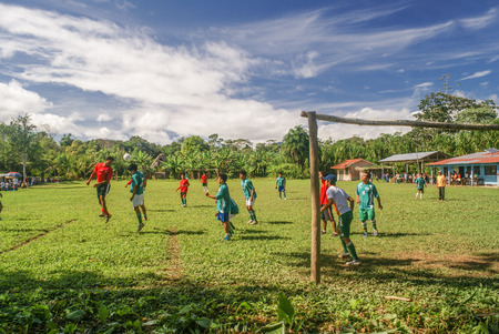 Villa Alcira, Bolivia - circa June 2009: Children dressed in red and green shirts play football match at Villa Alcira, Bolivia. Documentary editorial.