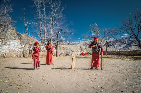 Hemis, Ladakh - circa November 2011: Monks play cricket at Tibetan Buddhist monastery in Hemis, Ladakh. Documentary editorial. Editorial