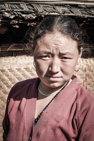 frowns: Kanchenjunga Trek, Nepal - circa May 2012: Native woman in pink shirt frowns in Kanchenjunga Trek, Nepal. Documentary editorial. Editorial