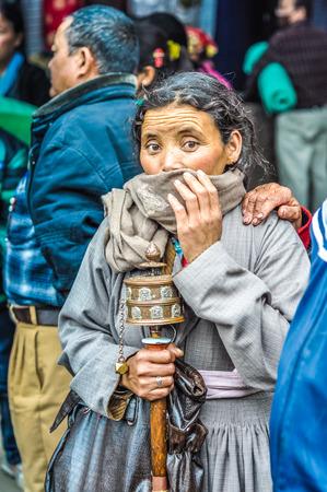 Bohdgaya, Bihar - circa January 2012: Native woman hides her mouth with scarf in Bohdgaya, Bihar. Documentary editorial.