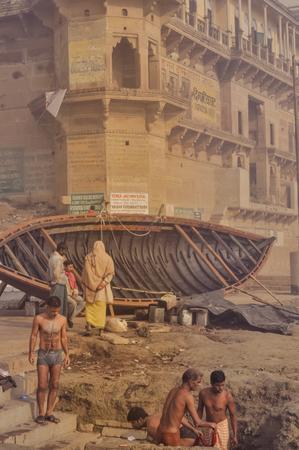 uttar pradesh: Varanasi, Uttar Pradesh - circa January 2012: Photo of native people near new ship in Varanasi, Uttar Pradesh. Documentary editorial.