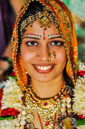 Bikaner, Rajasthan - circa December 2011: Photo of smiling bride wearing traditional jewellery during wedding ceremony in Bikaner, Rajasthan. Documentary editorial.