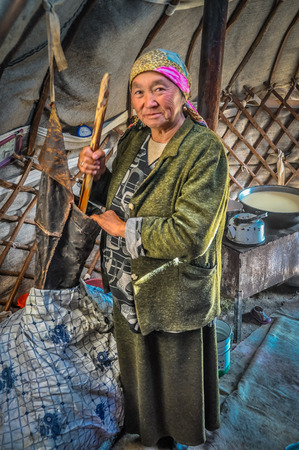 headcloth: Son Kol, Kyrgyzstan - circa September 2011: Older native woman with headcloth poses in her nomad tent in Son Kol, Kyrgyzstan. Documentary editorial.