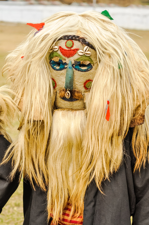 arunachal pradesh: Dirang, Arunachal Pradesh - circa February 2012: Native man poses in traditional mask on his face and and with long blonde wig in Dirang, Arunachal Pradesh. Documentary editorial.