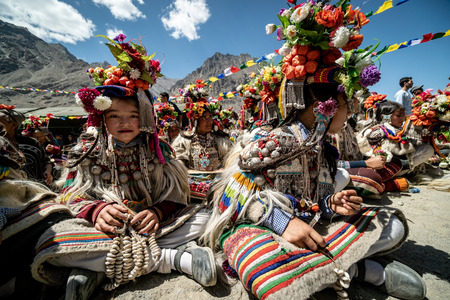 Ladakh, India - August 29, 2018: Indigenous children in traditional costumes awaiting their performance in Ladakh, India. Illustrative editorial. Sajtókép