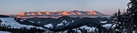 High Tatras, highest peaks of Carphatian Mountains lit by rising sun on freezing winter morning.