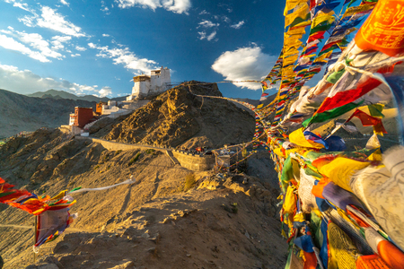 Buddhist Prayer flags connecting two peaks of Peak of Victory above Leh, Ladakh, India. Namgyal Tsemo Monastery on the top of the hill.