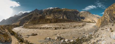 Scenic view Mountain river in valley of Karakoram Mountain Range on sunny day.