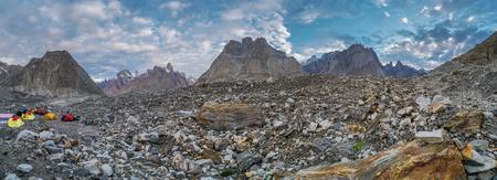 Campsite of group trekking to K2 base camp in Karakoram Mountain Range, Pakistan.