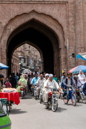 Lahore, Pakistan - August 5, 2018: Busy street in historical town of Lahore, Pakistan. Illustrative editorial.