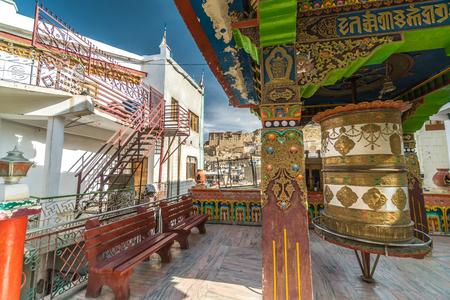 Typical decorated buddhist prayer wheel in town of Leh in Ladakh, India Foto de archivo - 118052192