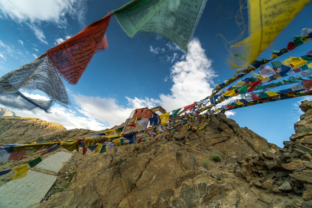Buddhist prayer flags near buddhist monastery Namgyal Tsemo above Leh, Ladakh in India. Place is a popular toutist attraction.