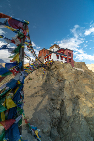 Prayer flags near buddhist monastery Namgyal Tsemo above Leh, Ladakh in India. Place is a popular toutist attraction.