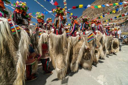 Ladakh, India - August 29, 2018: Performers in traditional costumes dancing in Ladakh, India. Illustrative editorial. Editorial
